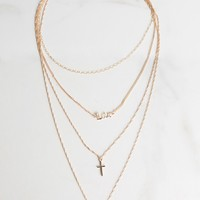 AKIRA 4 Tiered Metallic Chain Love Cross Charm Necklace in Gold