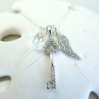 Silver key and wing Swarovski crystal necklace