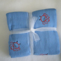Cotton Burp pad in blue flannel with red crabs