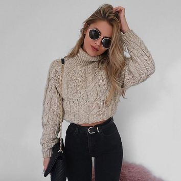 Twisted knitted turtleneck sweater