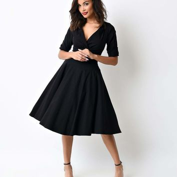Unique Vintage 1950s Black Delores Swing Dress with Sleeves
