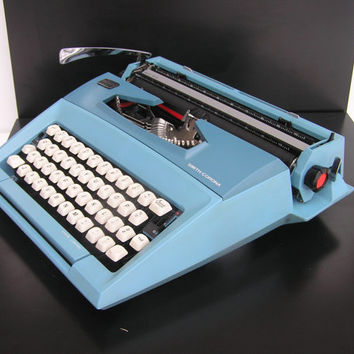 Typewriter light blue Smith Corona Courier good working condition lightweight new red black ribbon