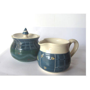 Vintage unique handmade and hand painted pottery cream and sugar bowl set. Blue and white ceramic set.
