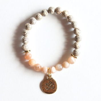 Lotus Seed Beads Bracelet with Orange Moonstones and Om Charm