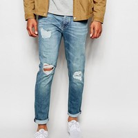 River Island | River Island Distressed Skinny Stretch Jeans with Rips at ASOS