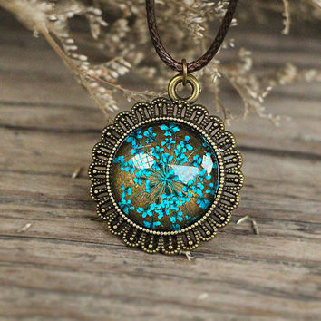 Light blue dried flower DIY jewelry,pressed flower necklace,lace flowers in low dome glass cap on a bronze metal bezel,botanical jewelry