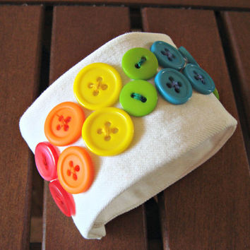 White jeans upcycled cuff bracelet decorated with a variety of colorful buttons