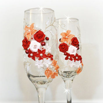 Beautiful hand decorated wedding or anniversary champagne glasses, elegant toasting flutes with pearls and roses