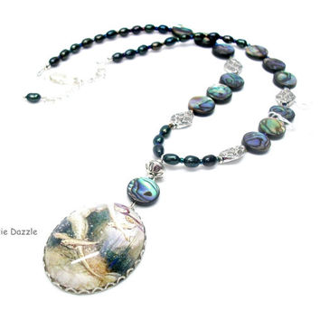Beach jewelry. Handmade glass cameo with vintage art mermaid, freshwater pearls and irridescent blue and green abalone shells.