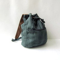 vintage army green rucksack. cotton one shoulder backpack. drawstring bag.