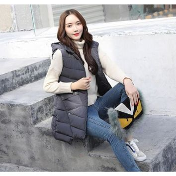 Womens Mid Length Zipped Up Puffer Vest with Hood in Gray