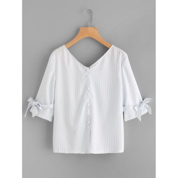 Double V-neckline Bow Tie Back Blouse