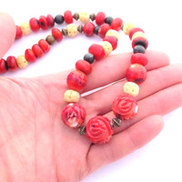 Bold colors and textures-One of a Kind Beaded Necklace with Coral, Marble and Carved Bone. Beautiful gemstones in red, black and creams.