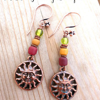 Copper sun and Indonesian glass boho earrings.