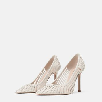 STRAPPY HEELED SHOES