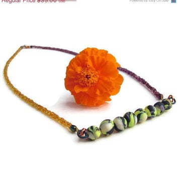 Seed beaded necklace purple and orange by BrandonArtists on Etsy
