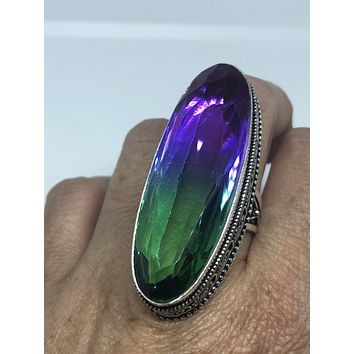 Vintage vintage Art Glass ring about two inch long knuckle ring