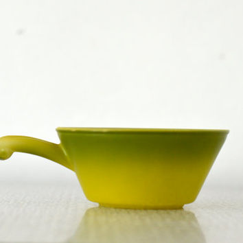 vintage fire king fade green bowl with handle
