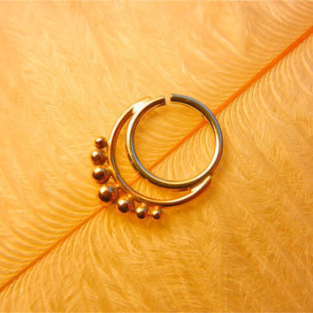 Anandini. An Indian Septum Ring. An Indian Nose Ring or a Belly Button Ring.