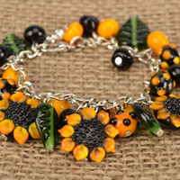 Wrist handmade interesting bracelet with lampwork glass beads Sunflowers present