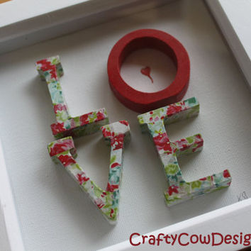 Box frame with wooden decoupage letters spelling LOVE in Kath Kidson like decoupage flowery red paper. Wall pictures, wall art