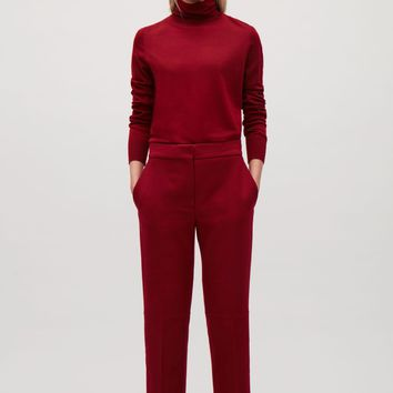 Cropped trousers with press folds - Red - Trousers - COS US