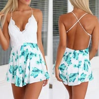 2015 Sexy Printed leafy lace stitching back cross playsuits SDS170