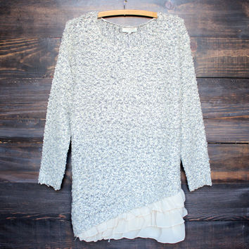 grey knit sweater with ruffle hem
