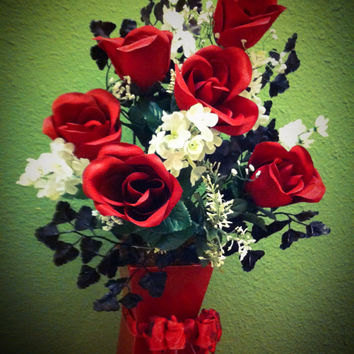 Handmade romantic floral arrangement. Eye catching  colors in matching vase.