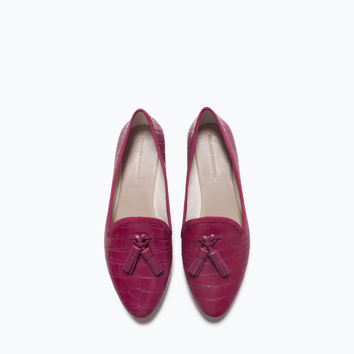 Flat shoes with tassels