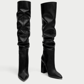 LEATHER HIGH HEEL BOOTS WITH WIDE LEG DETAILS
