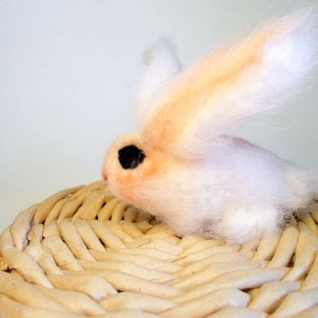 Сute miniature crocheted bunny.