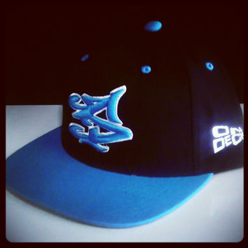 S LOGO SNAPBACK IN BLACK/TURQUOISE [SOLD OUT]