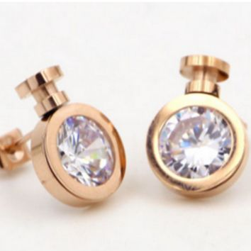 Perfume bottle single drill 18K golden ear nail female fashion titanium steel antiallergic and diamond-encrusted earrings jewelry girl accessories.