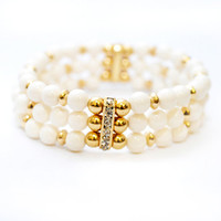 Multi Strand Ivory and Gold Stacked Stretch Bracelet