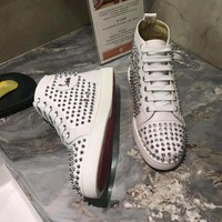 KUYOU Christian Louboutin red sole classic rivet Roller Boat CL white high-top shoes