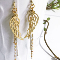 Gold feather beaded earrings. Feather charm. Antique glass seed beads. Handmade Lightweight Dangly. Boho jewelry. Feather pendant Tribal