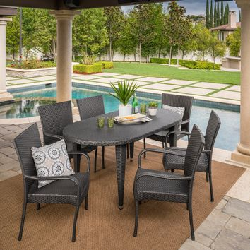 Sola Outdoor 7 Piece Gray Wicker Oval Dining Set with Stacking Chairs