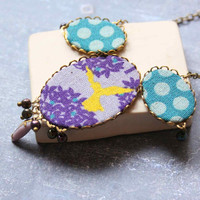 Statement Necklace with Yellow Bird in Steel Blue and Violet colors