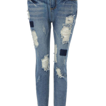 Blue Ripped Jeans In Vintage Wash