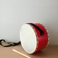 Vintage toy drum, red and white toy drum with wooden drumstick and black shoulder band, vintage toys, membrane and wood frum, mid seventies