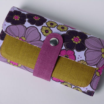 Handmade wallet sewn of cotton and linen fabrics with floral pattern with stud