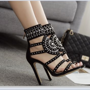 The new popular hollowed-out laser rhinestone boots for women with high heels