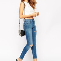 ASOS PETITE Ridley Ultra Skinny Jean In Putsborough Blue Midwash With Ripped Knee And Thigh Rip