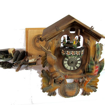 Black forest vintage. Music box. Wood clock. Wood wall clock. Clock parts. Mechanical clock. Cuckoo clock. Hand carved. Needs reassembly.