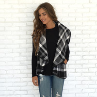 It's Black & White Plaid Vest