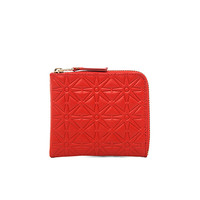 Comme Des Garcons Star Embossed Small Zip Wallet in Orange | FWRD