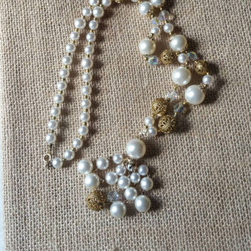 Long, vintage lariat with a clasp, faux pearls, and goldtone necklace