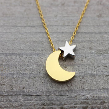 Gold crescent moon with tiny silver star on gold chain necklace
