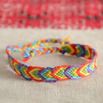 Handmade thin friendship wrist bracelet woven of colorful embroidery floss